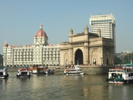 Bombay_-_gate_of_india_and_taj_mahal_hotel_-_seen_from_the_sea__india_small